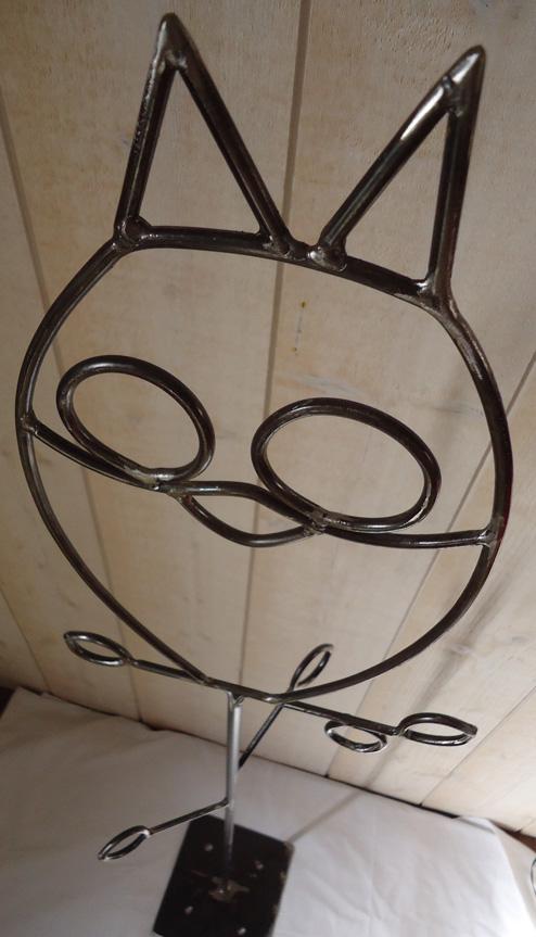 Porte manteau 'Hibou' sur pied - acier brut